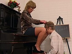 Older piano teacher dominates her student