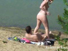 Spying on a couple fucking on a beach