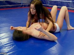 Busty fighter Denisa Doll is ready for a nude wrestling in the ring