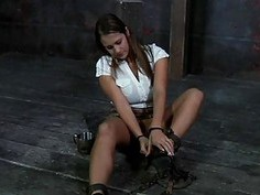 Clamped up hottie is receiving facial torture