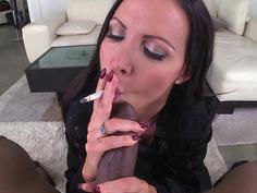 Nikki Benz lighting her cigarette and blowing smoke as she sucks BBC